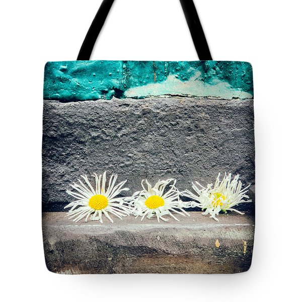 Tote Bag featuring the photograph Three Daisies Stuck In A Door by Silvia Ganora