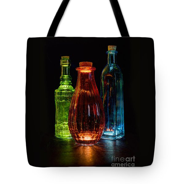 Tote Bag featuring the photograph Three Decorative Bottles by ELDavis Photography