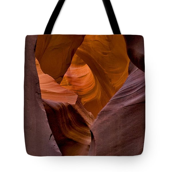 Tote Bag featuring the photograph Three Faces In Sandstone by Mae Wertz