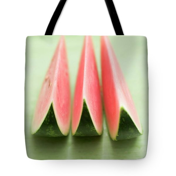 Three Wedges Of Watermelon On Green Table Tote Bag
