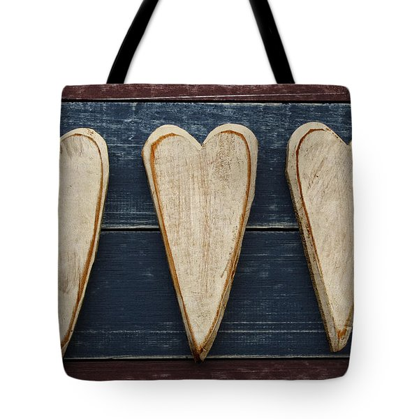 Three Wooden Hearts Tote Bag by Carol Leigh