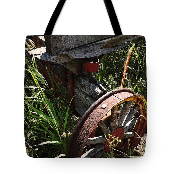 Tote Bag featuring the photograph Tireless by Meghan at FireBonnet Art