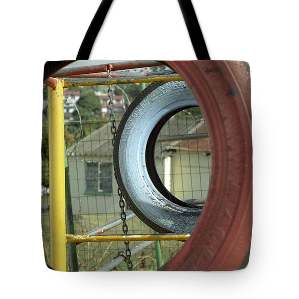 Tote Bag featuring the photograph Tires In An Orphanage by Susie Rieple