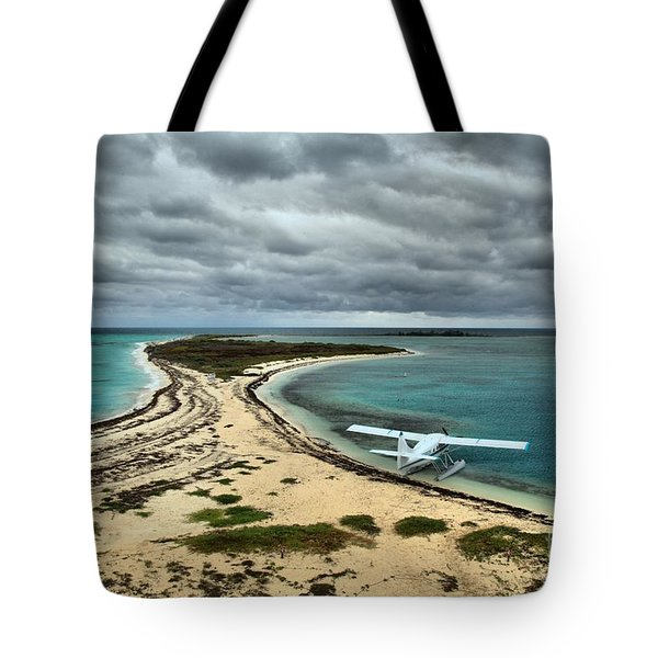 Touchdown At Tortugas Tote Bag by Adam Jewell