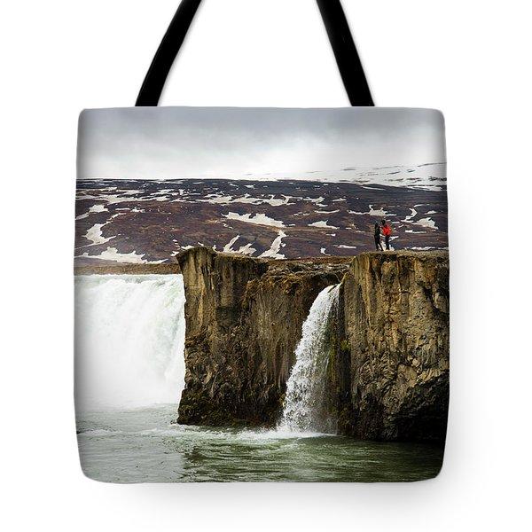 Tourist Exploring Godafoss Waterfall Tote Bag