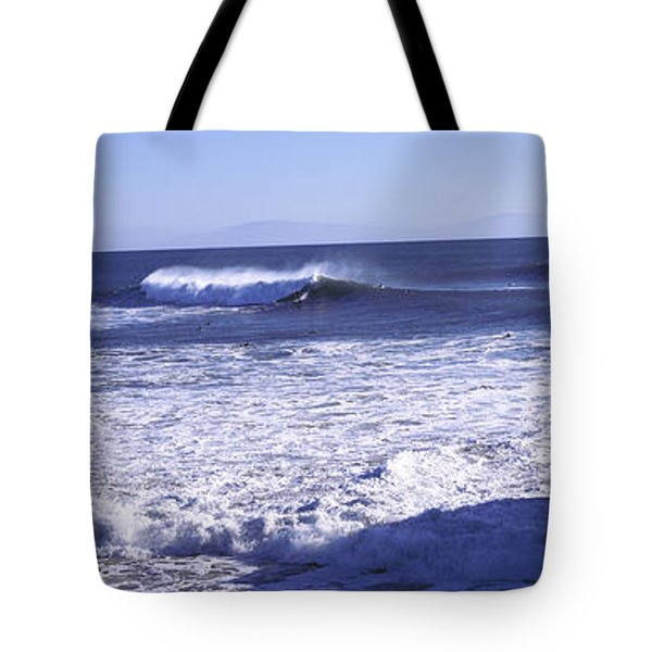 Tourist Looking At Waves In The Sea Tote Bag