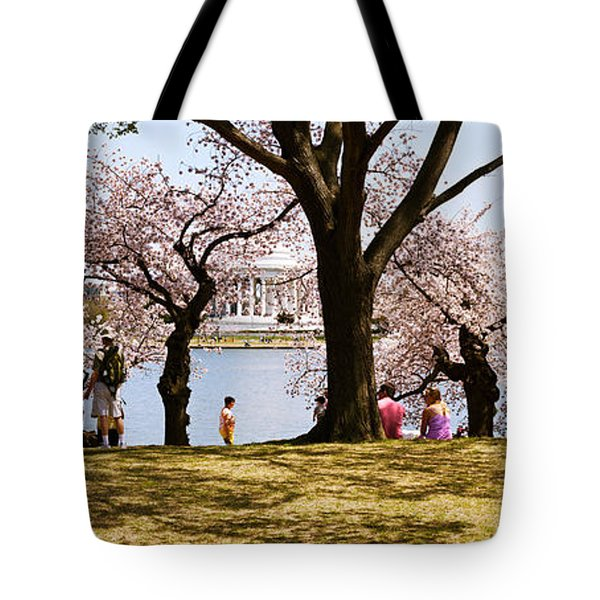 Tourists In A Park With A Memorial Tote Bag