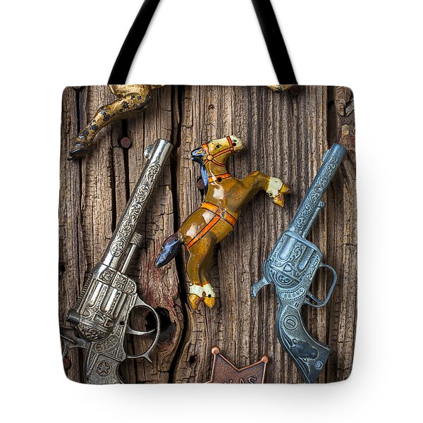 Toy Guns And Horses Tote Bag by Garry Gay