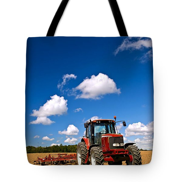 Tractor In Plowed Field Tote Bag by Elena Elisseeva