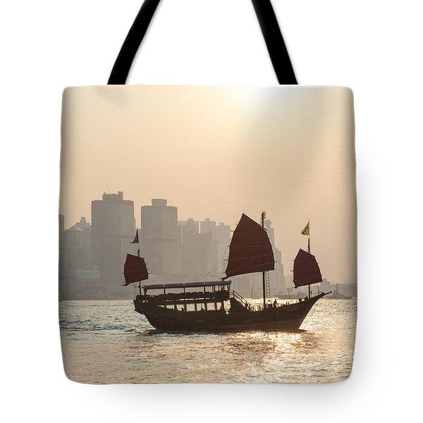 Traditional Junk Boat Sailing In Hong Kong Harbor Tote Bag
