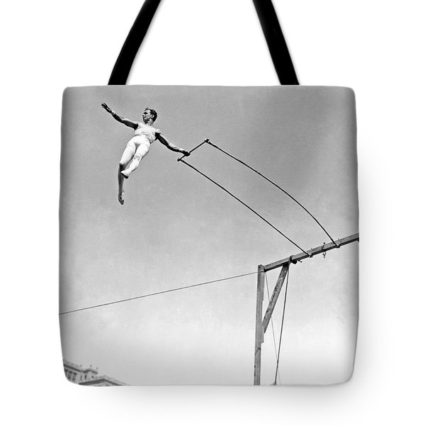 Trapeze Artist On The Swing Tote Bag by Underwood Archives