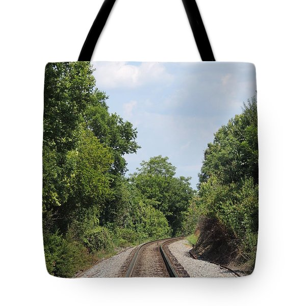 Tote Bag featuring the photograph Traxs To Anywhere by Aaron Martens