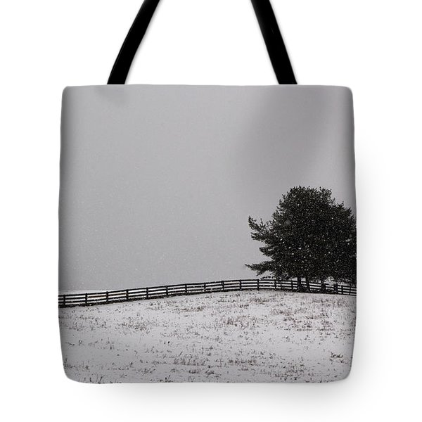 Tree And Fence In Snow Storm Tote Bag