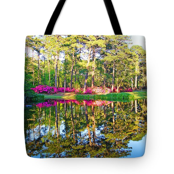Tree Reflections And Pink Flowers By The Blue Water By Jan Marvin Studios Tote Bag