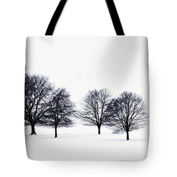 Trees In A Snowy Field In Chatsworth Tote Bag by John Doornkamp