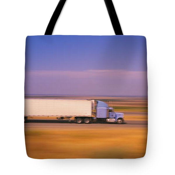 Truck And A Car Moving On A Highway Tote Bag