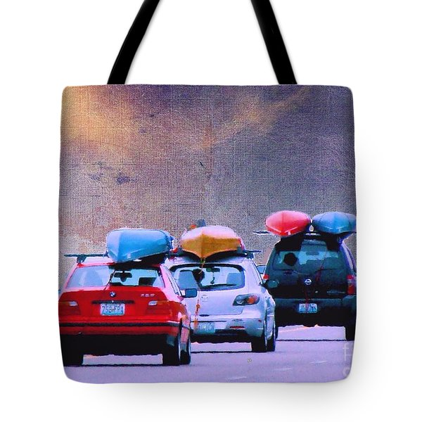 Tote Bag featuring the photograph Trying To Beat The Rain by Janette Boyd