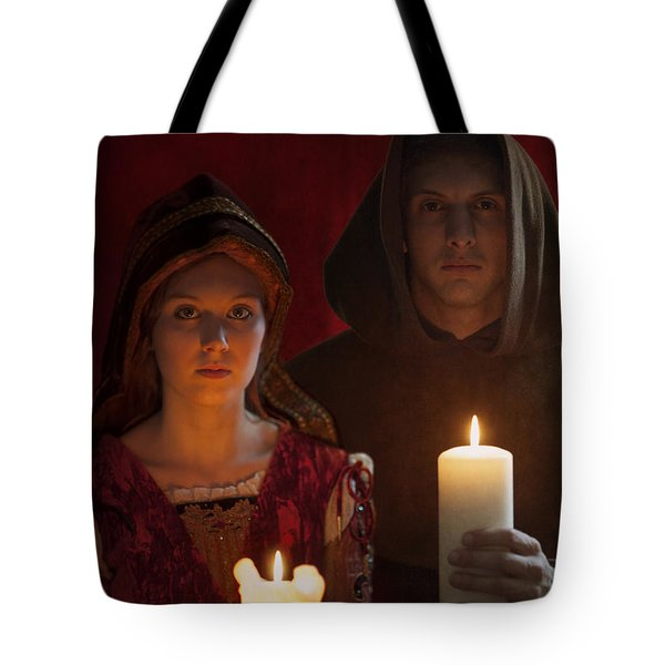 Tudor Medieval Young Attractive Couple  Holding  Candles Tote Bag by Lee Avison
