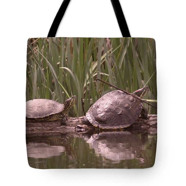 Turtle Struggling To Rest On A Log With Its Buddy Tote Bag by Jeff Swan