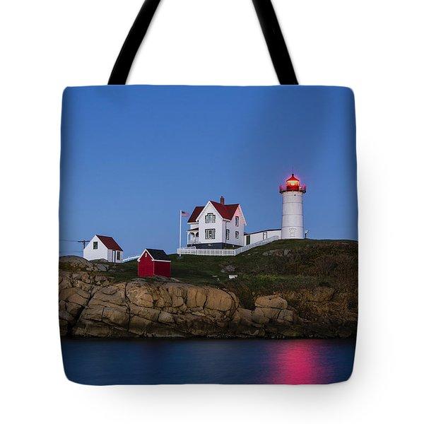 Twilight Nubble Lighthouse Tote Bag by John Greim