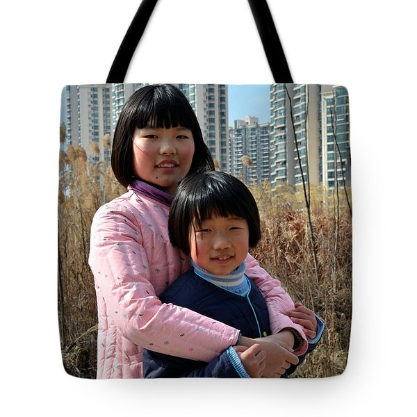 Two Chinese Teen Sisters Hug  And Embrace Shanghai China Tote Bag