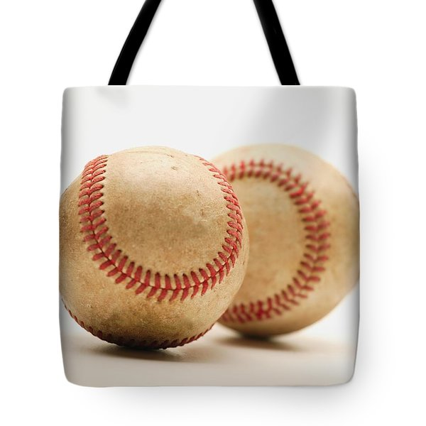 Two Dirty Baseballs Tote Bag by Darren Greenwood