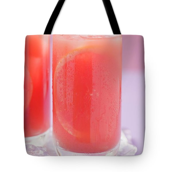 Two Glasses Of Pink Grapefruit Juice With Ice Cubes Tote Bag