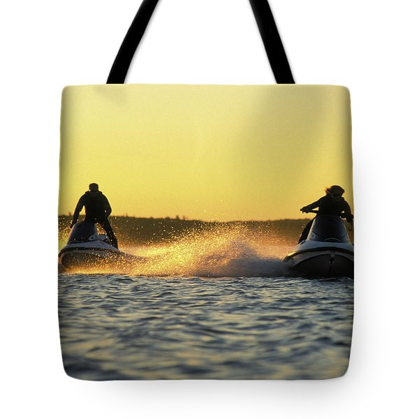 Two Jet Skis In Open Water At Sunset Tote Bag
