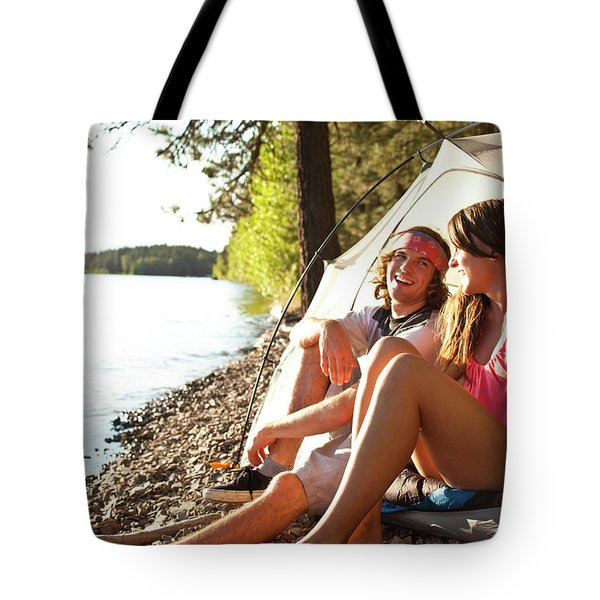 Two Young Adults Laugh And Smile Tote Bag