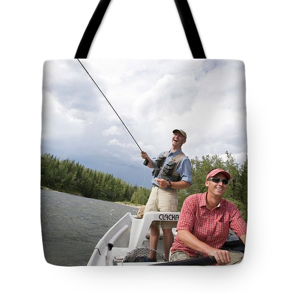 Two Young Men Fly Fishing On The Elk Tote Bag
