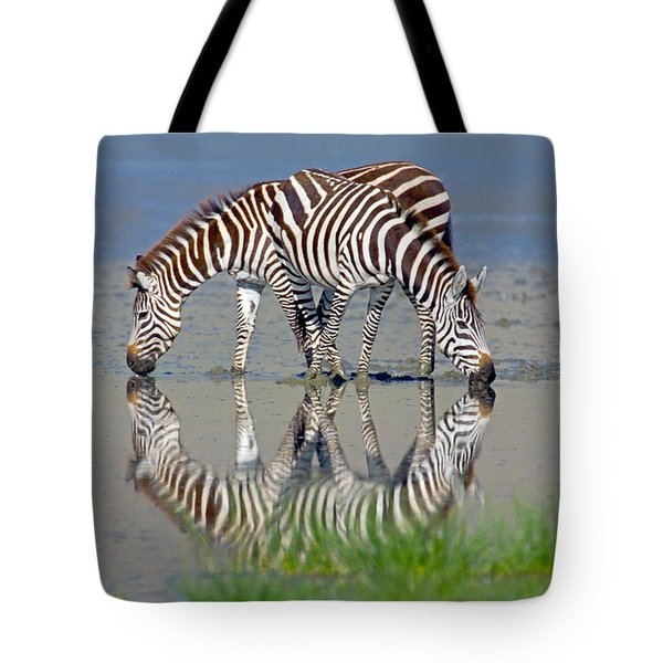 Two Zebras Drinking Water From A Lake Tote Bag