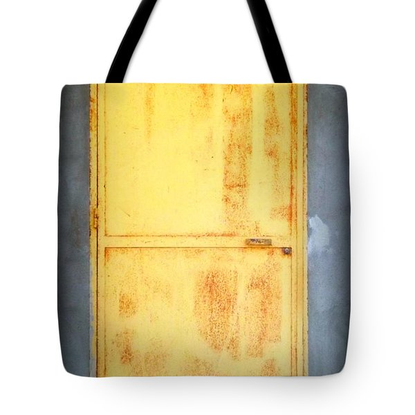 Tote Bag featuring the photograph Unused Door by Clare Bevan