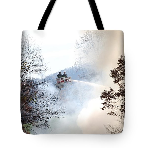 Tote Bag featuring the photograph Up In Smoke by Eric Liller