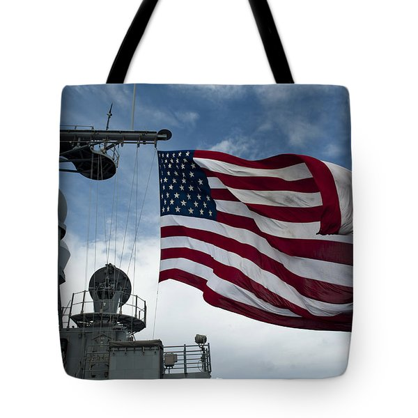 Uss Cowpens Flies A Large American Flag Tote Bag by Stocktrek Images