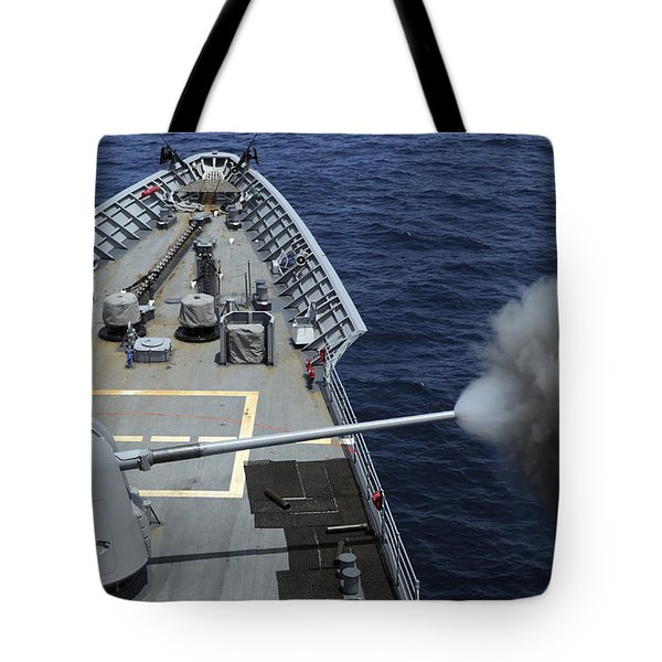 Uss Philippine Sea Fires Its Mk 45 Tote Bag by Stocktrek Images