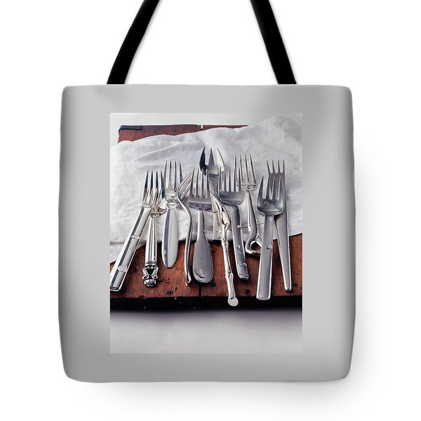 Various Forks On A Wooden Board Tote Bag