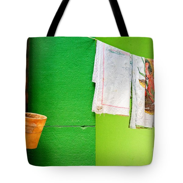 Tote Bag featuring the photograph Vase Towels And Green Wall by Silvia Ganora