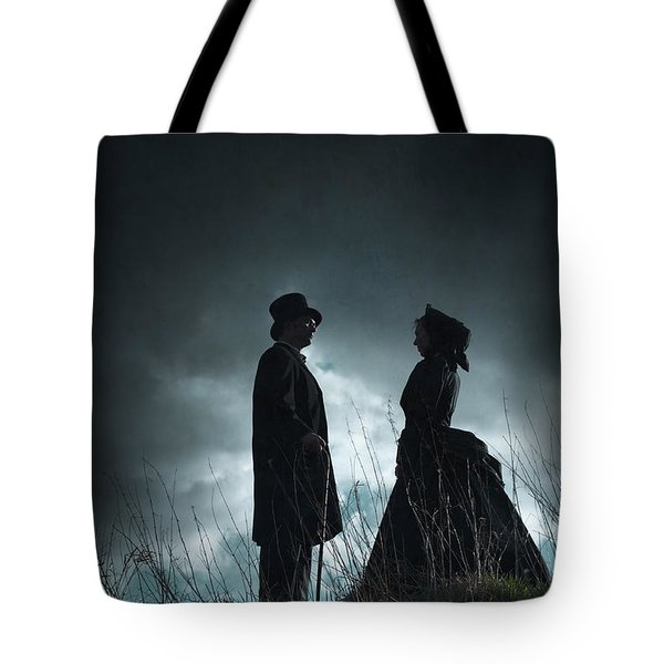 Victorian Couple Face On Another Before A Stormy Sky Tote Bag by Lee Avison