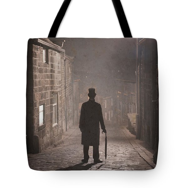 Victorian Man With Top Hat On A Cobbled Street At Night In Fog Tote Bag by Lee Avison