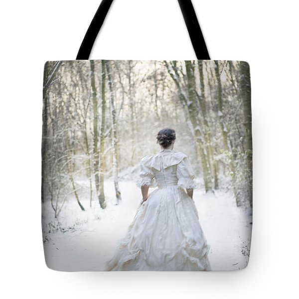 Victorian Woman Running Through A Winter Woodland With Fallen Sn Tote Bag