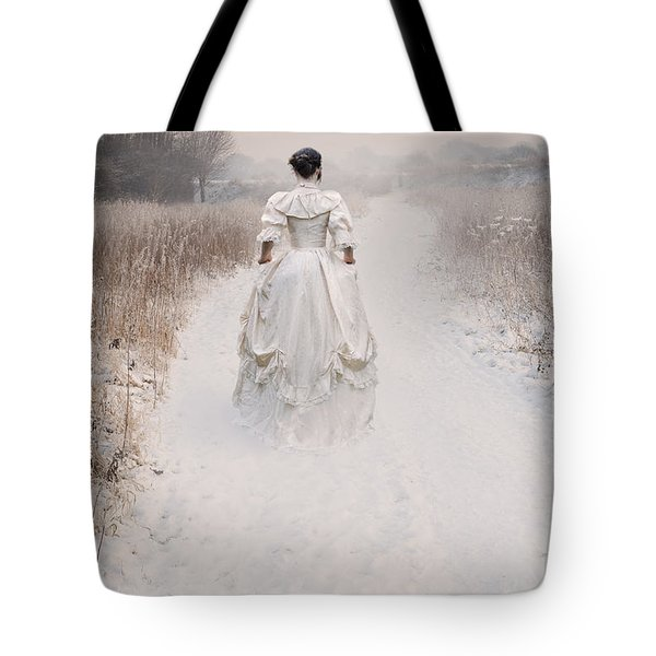 Victorian Woman Walking Through A Winter Meadow Tote Bag