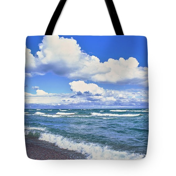 View Of Lakeshore Against Cloudy Sky Tote Bag