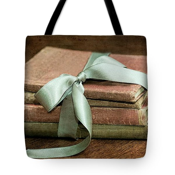 Tote Bag featuring the photograph Vintage Books Tied With Mint Ribbon by Tracie Kaska