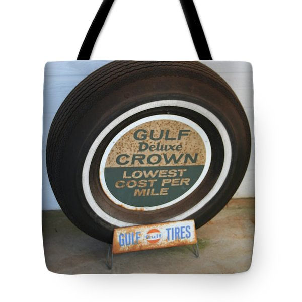 Tote Bag featuring the photograph Vintage Gulf Tire With Ad Plate by Lesa Fine
