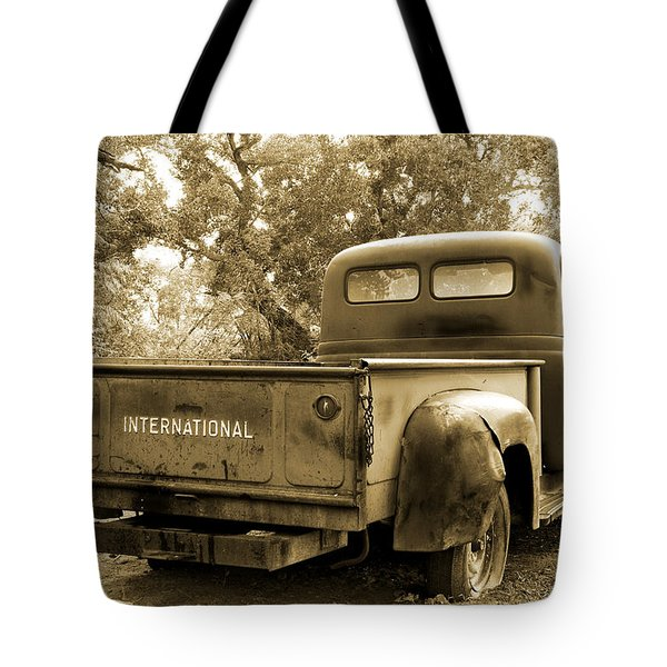Tote Bag featuring the photograph Vintage International by Steven Bateson