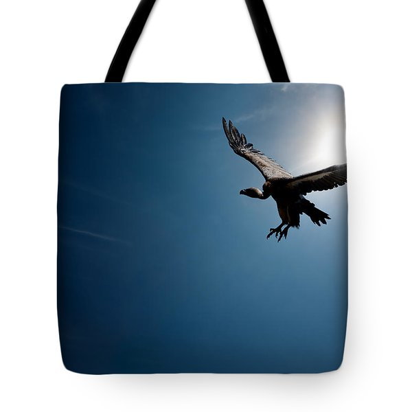 Vulture Flying In Front Of The Sun Tote Bag by Johan Swanepoel