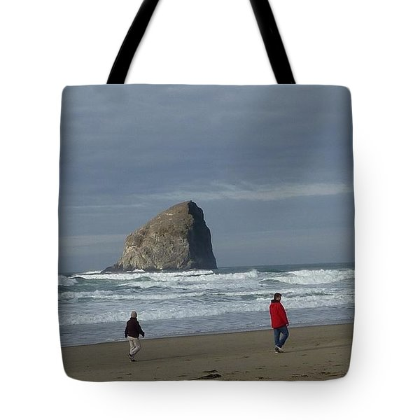 Tote Bag featuring the photograph Walking On The Beach by Susan Garren