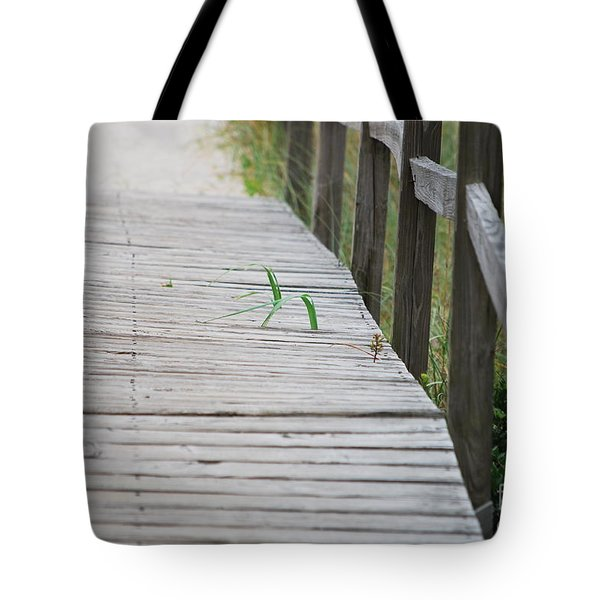 Tote Bag featuring the photograph Walkway Weeds by Bob Sample