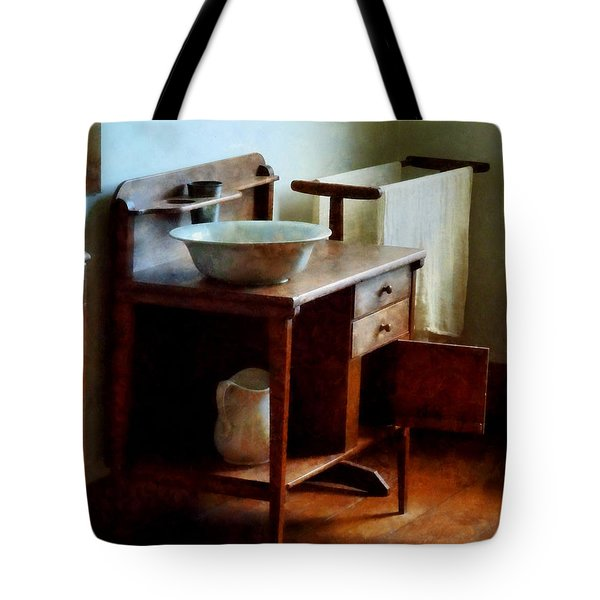 Tote Bag featuring the photograph Wash Basin And Towel by Susan Savad
