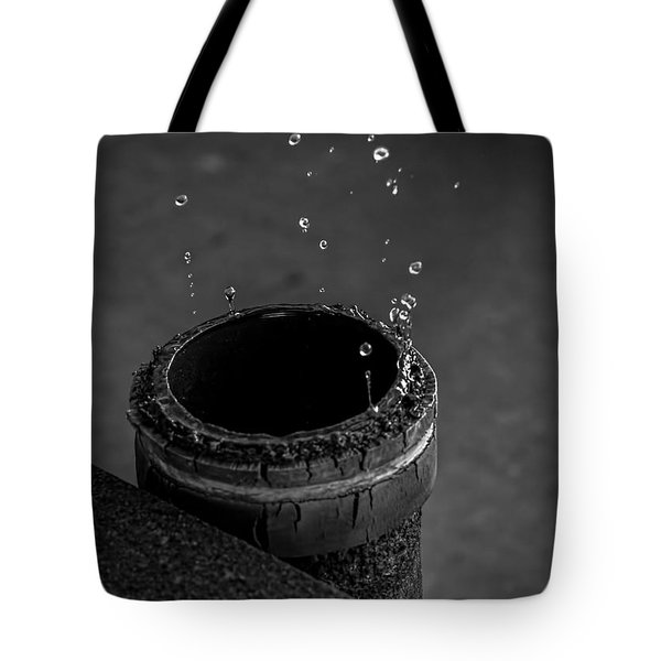 Water Dripping Up The Spout Tote Bag by Bob Orsillo